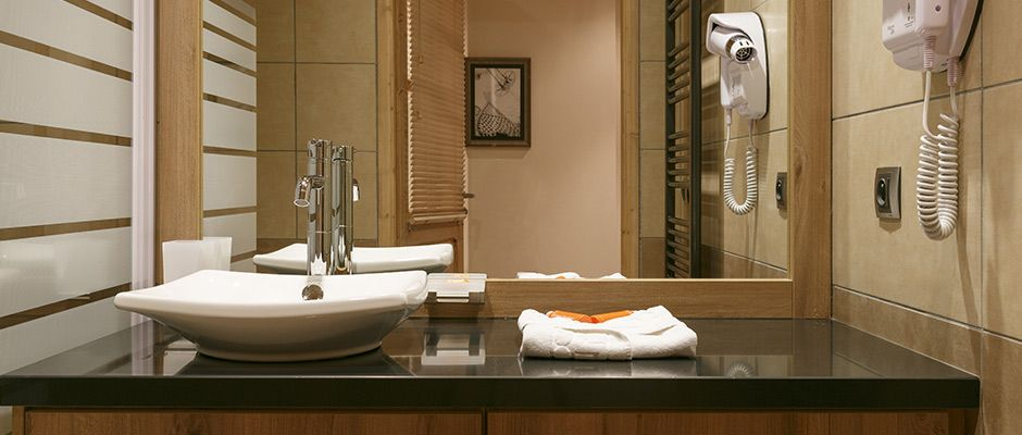 La salle de bain de l'appartement - Le Napoléon à Montgenèvre